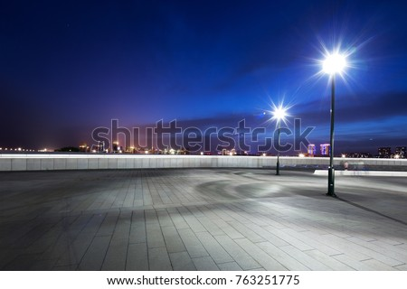 empty marble floor with street light in midtown of tianjin at night