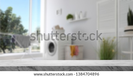 Empty marble table in laundry room. Mockup for design  #1384704896