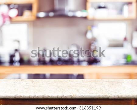 Empty marble table top and blurred kitchen bokeh light in background, Mock up for display of product