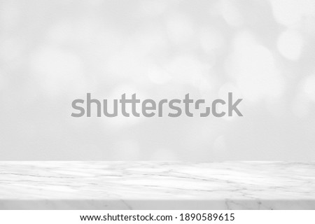Empty Marble Table with White Bokeh on Concrete Wall Background for Product Presentation.