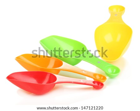Empty measuring cups for washing powder isolated on white