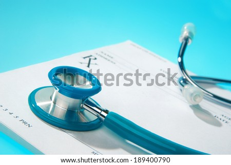Empty medical prescription on blue, reflective background