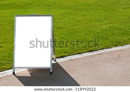 empty metallic board next to a grass field (isolated on white, focus on the grass)