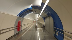 Empty metro tunnel. Underground tunnel in the city. Underpass with a moving walkway.