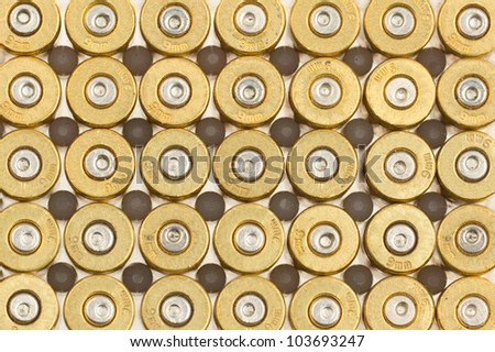 Empty 9mm bullet casings in a row