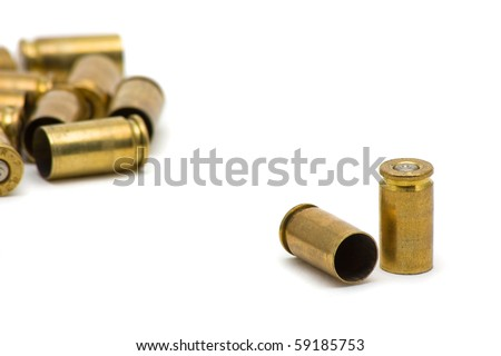 Empty 9mm bullet casings over white background