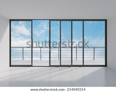 Empty modern lounge area with large window and view of sky with clouds #214040314