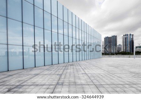 empty, modern square and skyscrapers in modern city #324644939