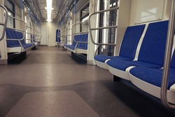 Empty Moscow metro car with blue seats