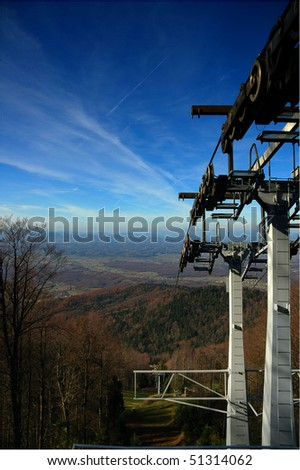 Empty mountain cable car elevator in off-season time - stock photo