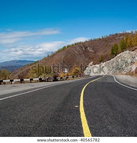 Empty mountain road with yellow marking