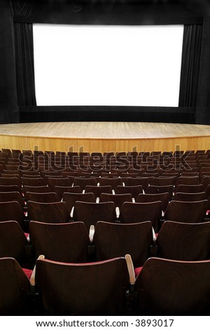 empty movie screen, black open curtain, wooden stage, wooden seats