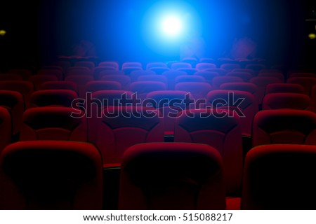 Empty movie theater with projection light falling into the lens