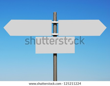 empty multidirectional sign against a blue sky (boards isolated on grey, ready for your design)