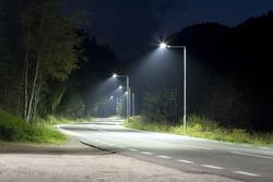 empty night road with modern streetlights