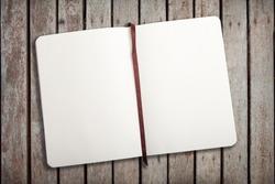 Empty notebook opened on wood-ground