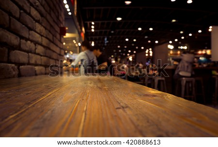 Empty of wood counter bar with blur cafe restaurant in dark background/selective focus .For montage product display #420888613
