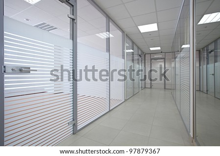 Empty office with glass walls and doors