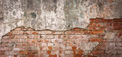 Empty Old Brick Wall Texture. Painted Distressed Wall Surface. Grungy Wide Brickwall. Grunge Red Stonewall Background. Shabby Building Facade With Damaged Plaster. Abstract Web Banner. Copy Space