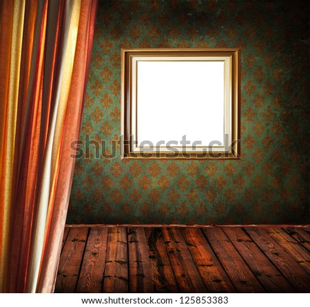 Empty old grunge room with empty golden frame