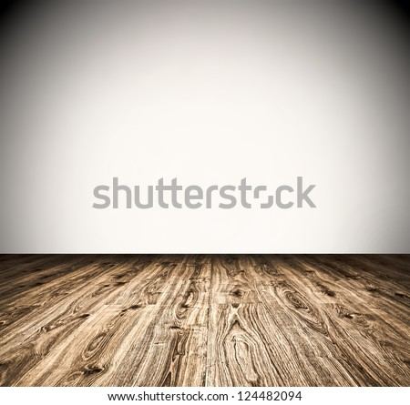 Empty old spacious room with wooden grungy wall and weathered dirty floor, vintage background texture