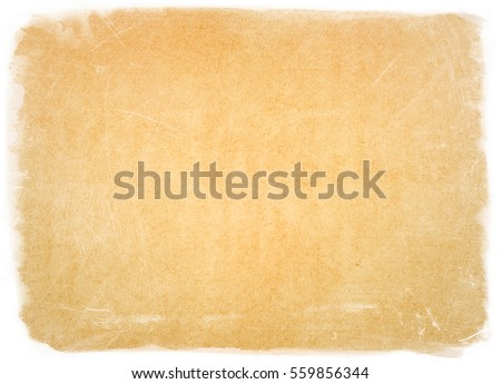 empty old vintage paper background in frame. Weathered and ancient Kraft Paper texture - Shutterstock ID 559856344