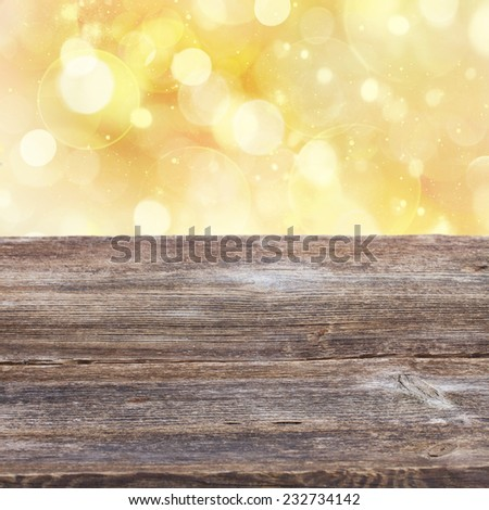 empty old wooden table with golden sparkles  background