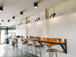 Empty on people . Coffee shop   interior design With chairs and white walls.