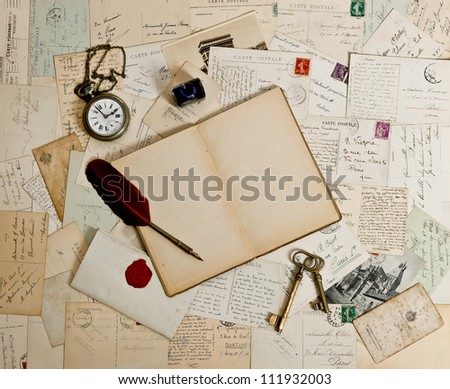 empty open book, old accessories and post cards. romantic vintage background - stock photo