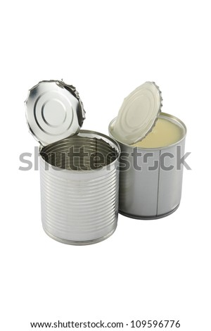 Empty opened in front of full closed sweet milk tin can on white background.