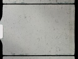 empty or blank 8mm film frame with black border and dust.
