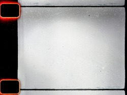 empty or blank 16mm film frame with black border and dust. film scan.