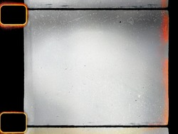 empty or blank 16mm film frame with black border, dust and light leak. film scan.