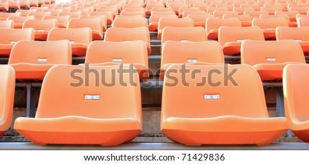 empty orange stadium seats