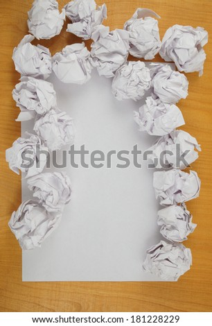 Empty paper, crumpled paper on wooden table