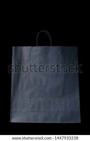 empty paper gray bag from Kraft paper, mocap, isolate, on a black background, the concept of waste-free production, ecology, on a black background