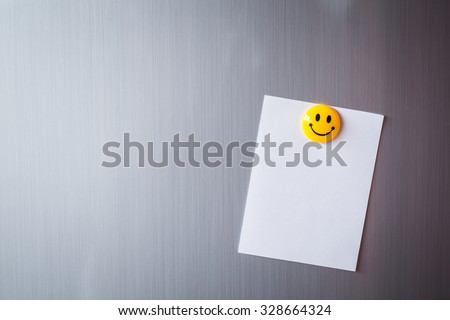 Empty paper sheet on refrigerator door