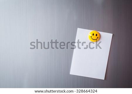 Empty paper sheet on refrigerator door