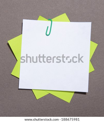 Empty paper sheets on grey background