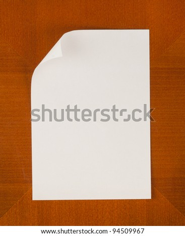 Empty paper with angled corner on wooden Background vertical