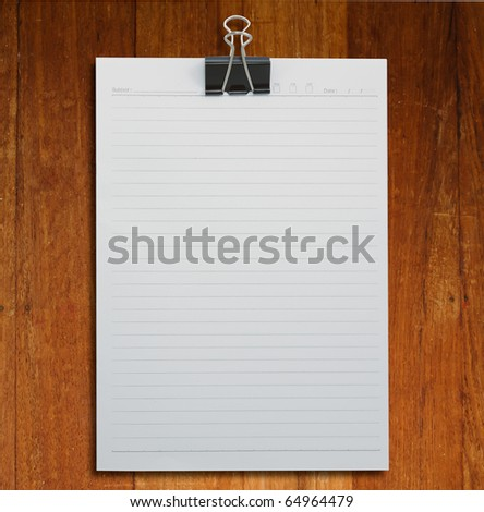 Empty Paper with Paper clip on wood