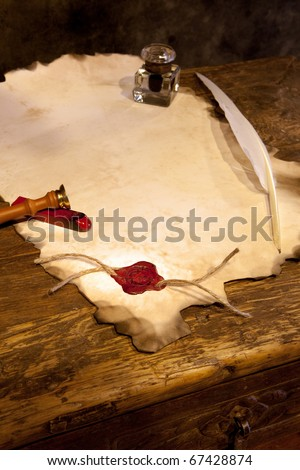 Empty parchment scroll with wax seal and feather quill