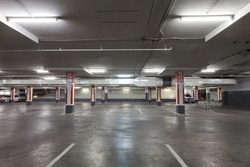 Empty parking garage underground interior  in apartment or in supermarket