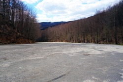 Empty parking in nature, no car, no tourists