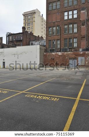 Empty parking lot and buildings in rundown downtown area, Cincinnati, USA
