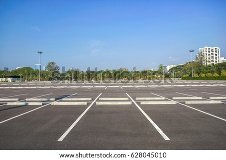 Empty parking lot at city center with blue sky #628045010