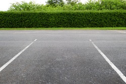 Empty parking lot in outdoor parking area.