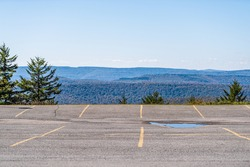 Empty parking lot in small skiing resort town village of Snowshoe, West Virginia in autumn with nature view on Allegheny mountains
