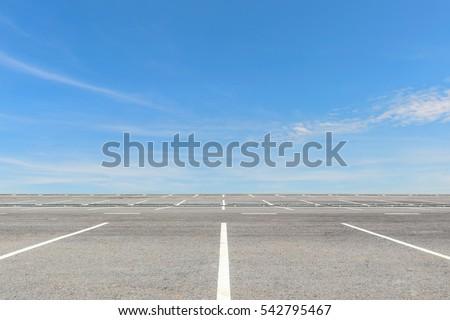 Empty parking lot on blue sky background #542795467