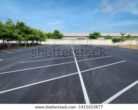 Empty parking lot,Parking lane outdoor in public park on blue sky background. #1415653877